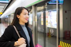 Girl waiting for the metro at subway station Royalty Free Stock Image