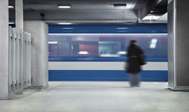 Girl Waiting the metro. A Girl Waiting the metro to stop. A long exposure with a lot of movement Royalty Free Stock Photos