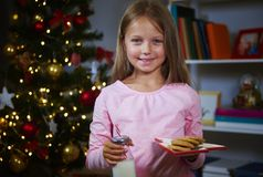 Girl waiting for Santa. Girl with cookie and milk Waiting for santa claus Stock Photography