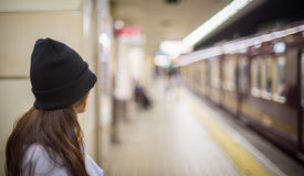 A girl is waiting for Subway train in Japan Royalty Free Stock Images