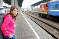 Girl waiting train Royalty Free Stock Images