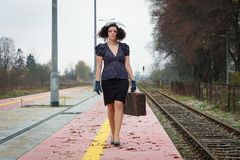 Girl waiting for train. On empty railroad platform Royalty Free Stock Photography