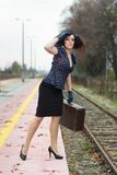 Girl waiting for train. On empty railroad platform Royalty Free Stock Images