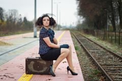 Girl waiting for train. On empty railroad platform Royalty Free Stock Photo