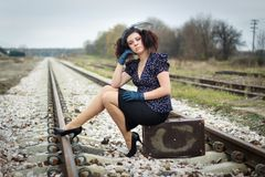 Girl waiting for train. Lonely girl waiting for train Royalty Free Stock Photography