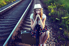Girl waiting for the train.Photo toned in retro style. Royalty Free Stock Image