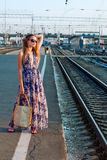 Girl waiting train on the platform Royalty Free Stock Photos