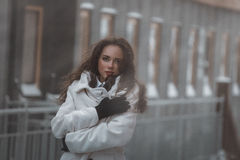 Girl waiting train on the platform of railway station Royalty Free Stock Photography
