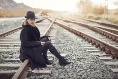 Girl waiting train. On the platform of railway station Stock Photo
