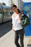 Girl waiting for the tram. Girl with bag waiting for the tram Royalty Free Stock Images