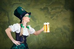Girl waitress oktoberfest in national costume with a mug of beer Royalty Free Stock Image