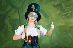 Girl waitress oktoberfest in national costume with a mug of beer Royalty Free Stock Photos