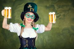 Girl waitress oktoberfest in national costume with a mug of beer Stock Images