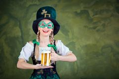 Girl waitress oktoberfest in national costume with a mug of beer Stock Photo