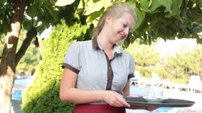 Girl waitress with a tray of summer. Serving stock footage