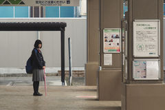 A girl waits the bus Stock Photos