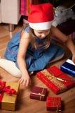 Girl waits gifts Stock Photos