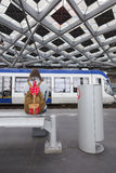 Girl waits for tram on The Hague Central Station Royalty Free Stock Image