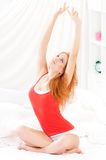 Girl wake up on bed Royalty Free Stock Photos