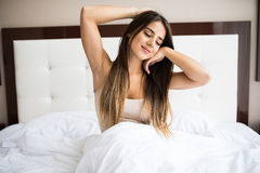 Girl wake up in the morning at home. Good morning!!! Young beautiful girl wake up in the morning at home royalty free stock photo