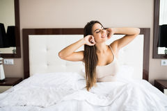 Girl wake up in the morning at home. Young beautiful girl wake up in the morning at home royalty free stock images