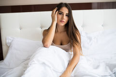 Girl wake up in the morning at home. Young beautiful girl wake up in the morning at home royalty free stock photography