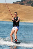 Girl wakeboarding Stock Images