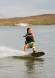 Girl Wakeboarding in Desert Sunshine Royalty Free Stock Images