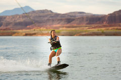 Girl Wakeboarding in Desert Sunshine Stock Image