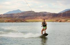 Girl Wakeboarding in Desert Sunshine Royalty Free Stock Photography
