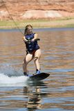 Girl Wakeboarding at Lake Powe royalty free stock photo