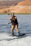 Girl Wakeboarding at Lake Powe Royalty Free Stock Image