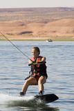 Girl Wakeboarding at Lake Powe Royalty Free Stock Photos