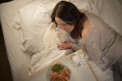 Girl wakes cat in the morning Royalty Free Stock Image