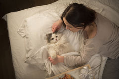 Girl wakes cat in the morning Royalty Free Stock Photo