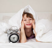 Girl wakes up. Cute little girl unwilling to wake up in the morning Royalty Free Stock Images
