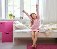 Girl wakes up Stock Photo