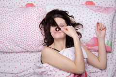 Girl waking clocked a strand of hair on the nose Stock Photo