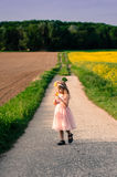 Girl waking in path Royalty Free Stock Photos