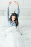 Girl waking up and stretching Stock Image