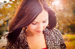 Girl on a walk in autumn. In the rays of sunset Royalty Free Stock Photography
