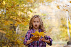 girl on walk in autumn park Stock Photo