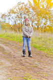 Girl on walk in autumn park Stock Images