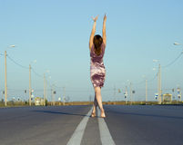 Girl walk barefoot on empty road Royalty Free Stock Photos