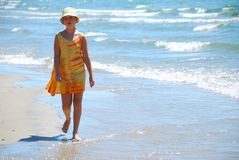 Girl walk beach Stock Image