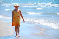 Girl walk beach. Young girl walking on a beach Royalty Free Stock Images