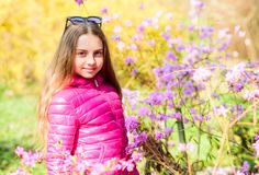 Girl walk in botanical garden. Enjoying nature in garden. Kid cute fancy child spend time in park. Plants grown for royalty free stock photography