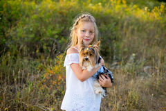 Girl on walk with dog. Warm summer vacations close up Stock Images