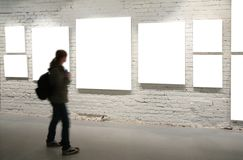 Girl walk through frames on brick wall stock photos