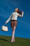 Girl walk on on grass Stock Image